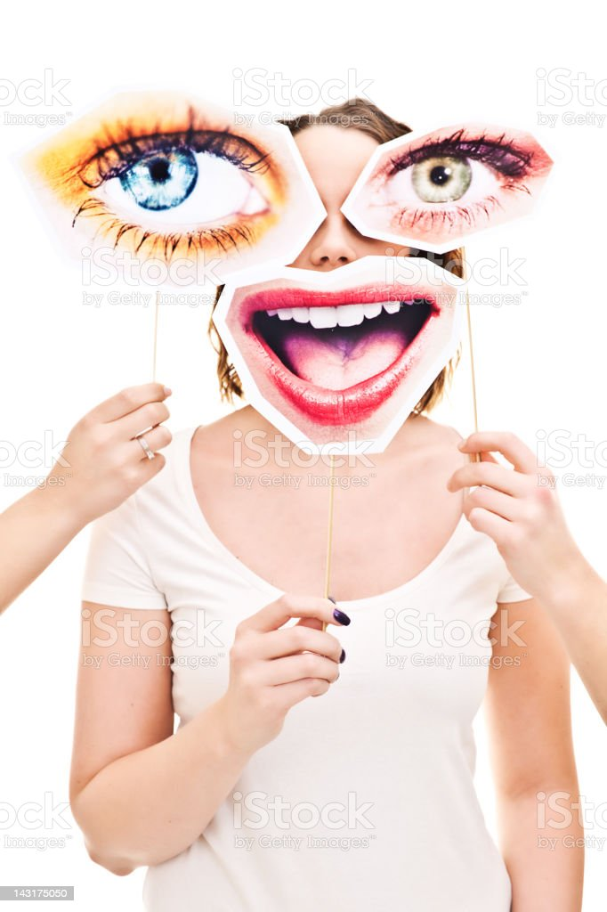 Woman with eyes and smile signs infront of her stock photo