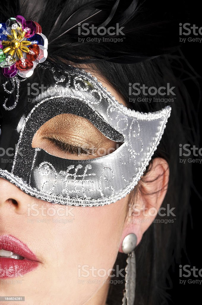 Woman with eyes closed in mask. stock photo