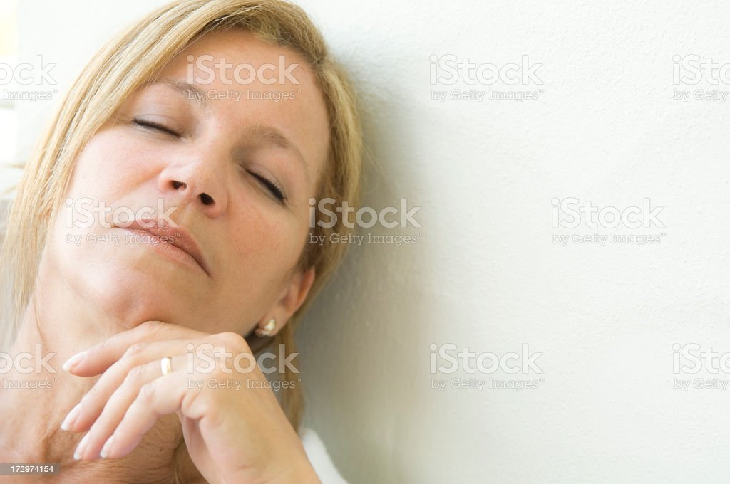 Woman with eyes closed royalty-free stock photo