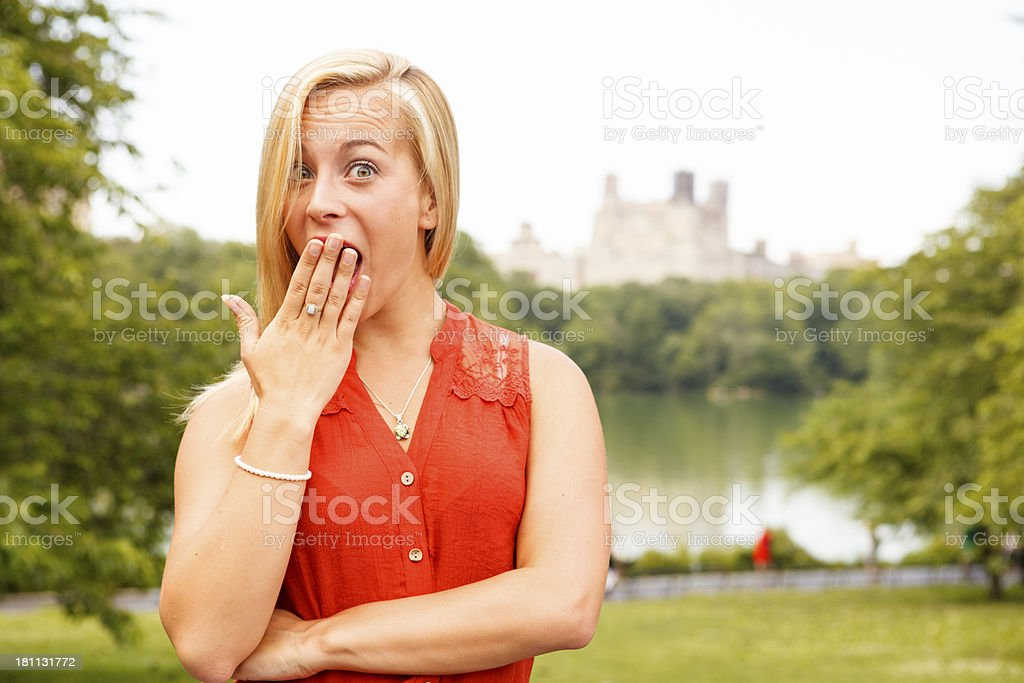 Woman with Eyes Wide Open and Hand to Mouth royalty-free stock photo