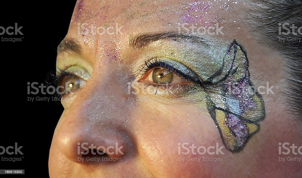 Woman with face painted f royalty-free stock photo