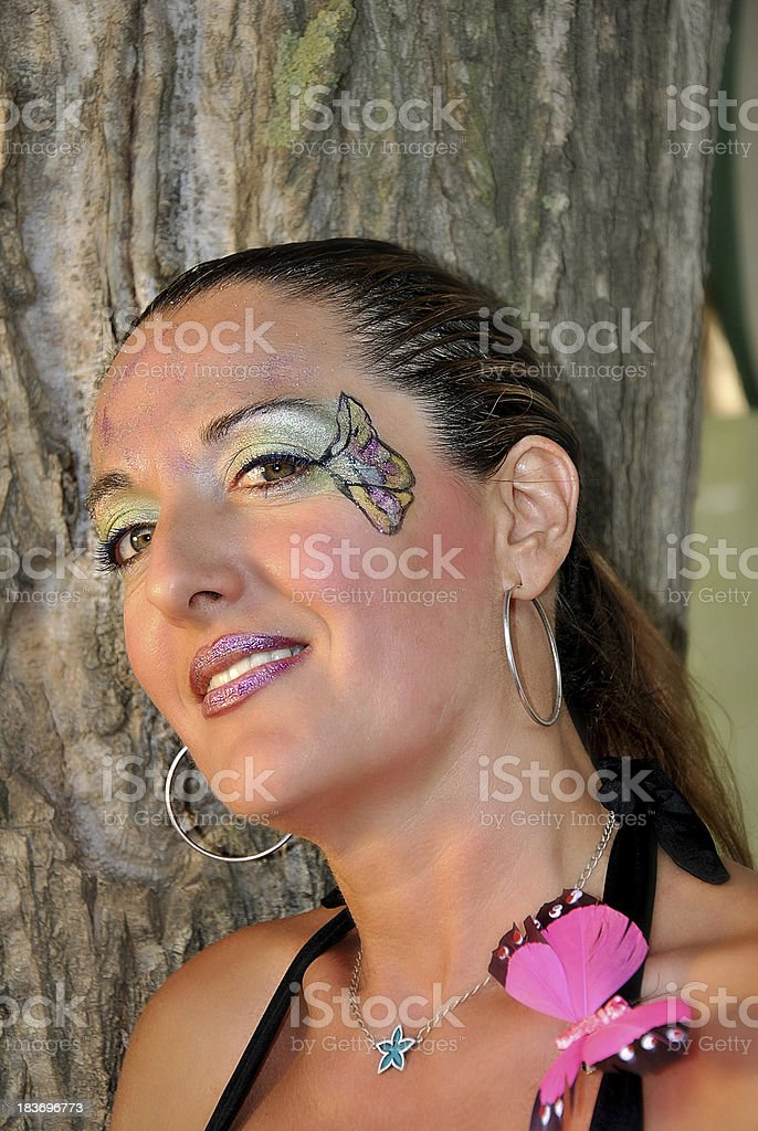 Woman with face painted royalty-free stock photo