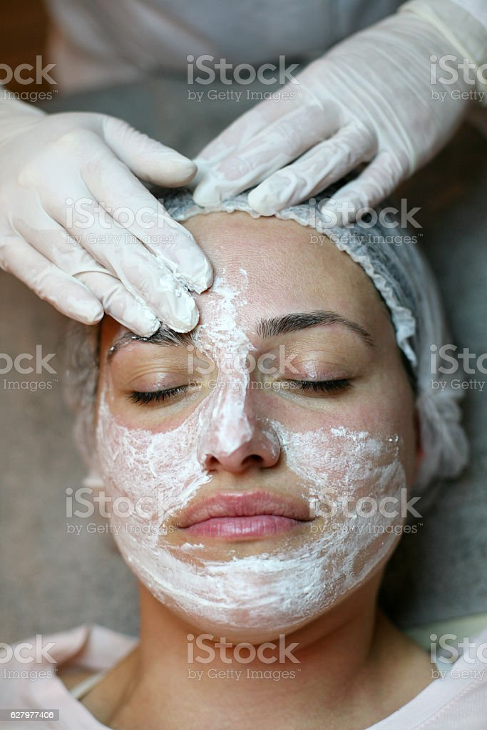 Woman with facial mask in a spa center. stock photo