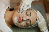 Woman with  facial mask in  spa center.