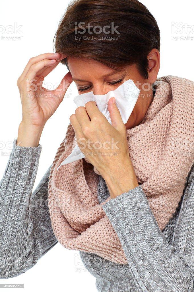 Woman with facial tissue having flu. stock photo