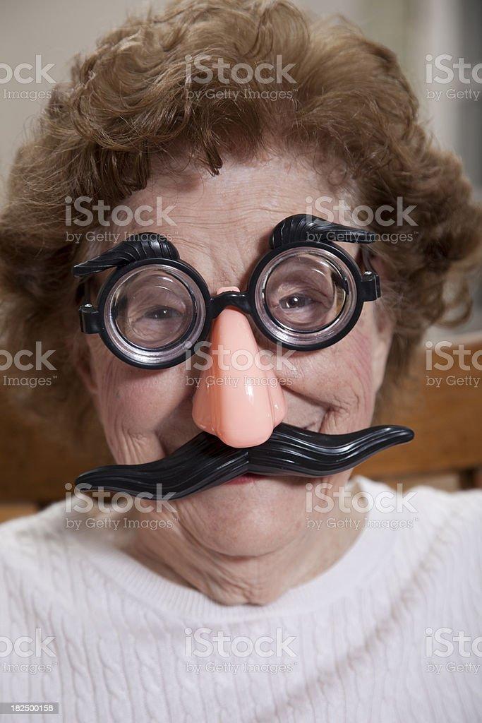 Woman with fake eyeglasses stock photo