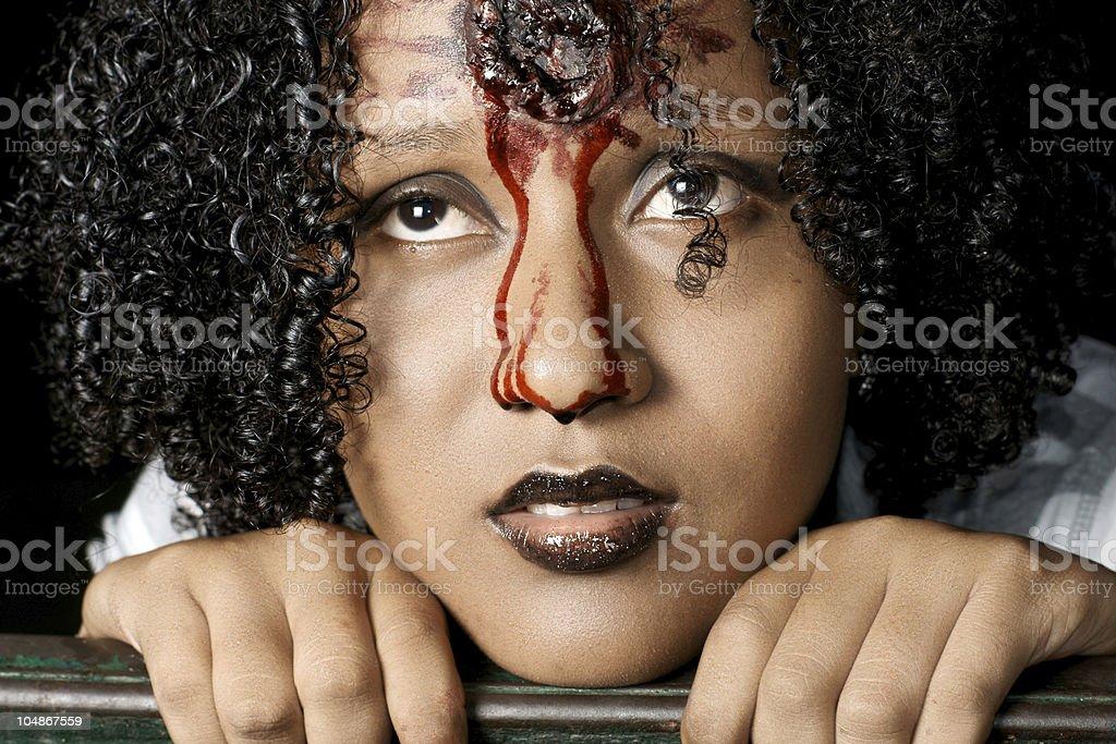 Woman with fake gunshot wound royalty-free stock photo