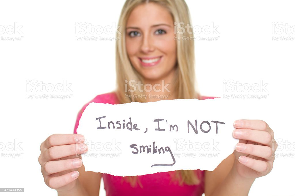 Woman with fake smile expressing depressed thoughts royalty-free stock photo