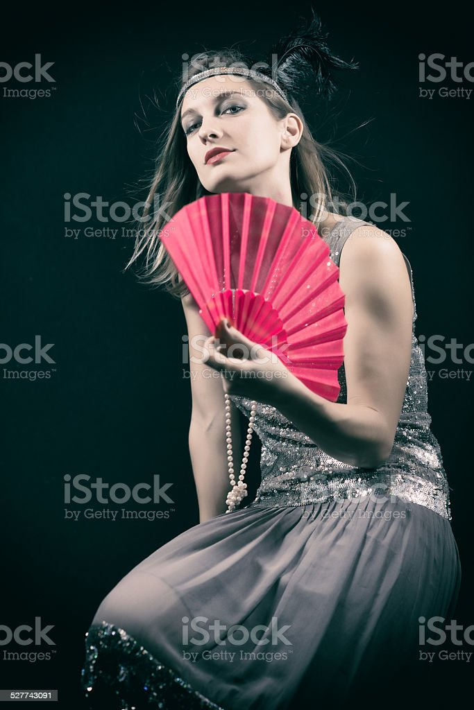 woman with fan stock photo