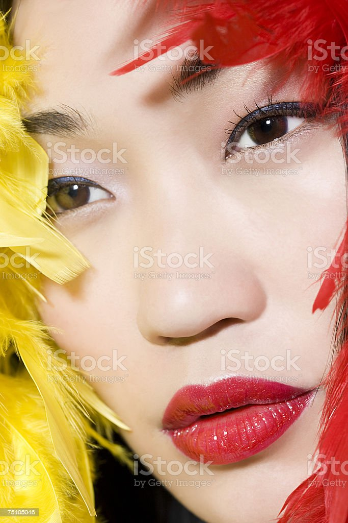 Woman with feathers around her face royalty-free stock photo
