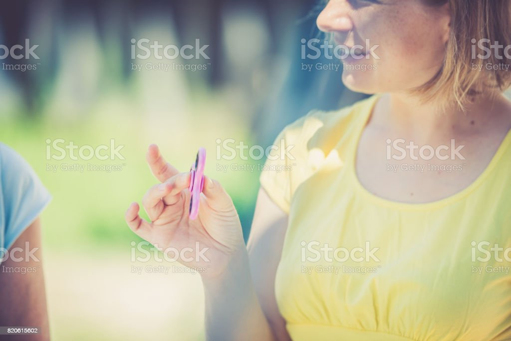 Woman with fidget spinner in her hands close up stock photo