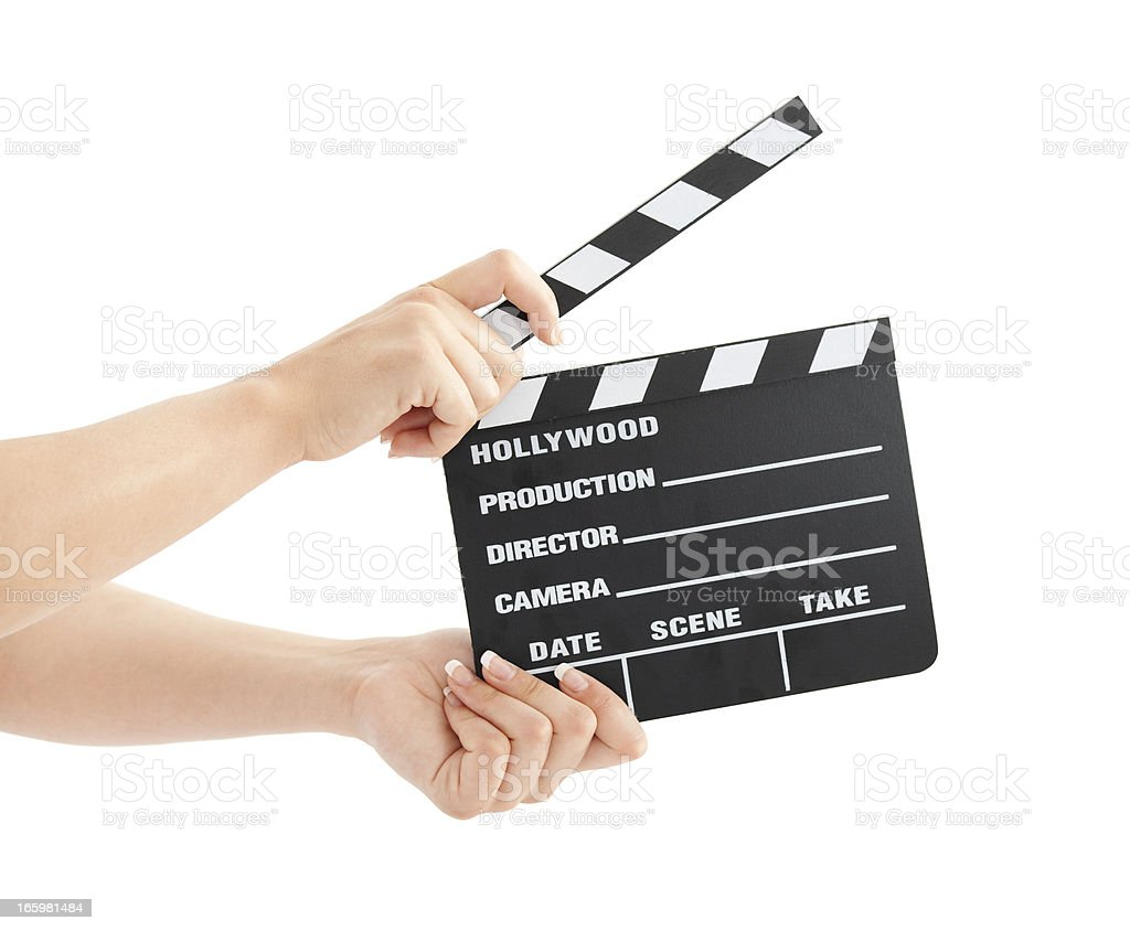 Woman with film clapper on white background stock photo