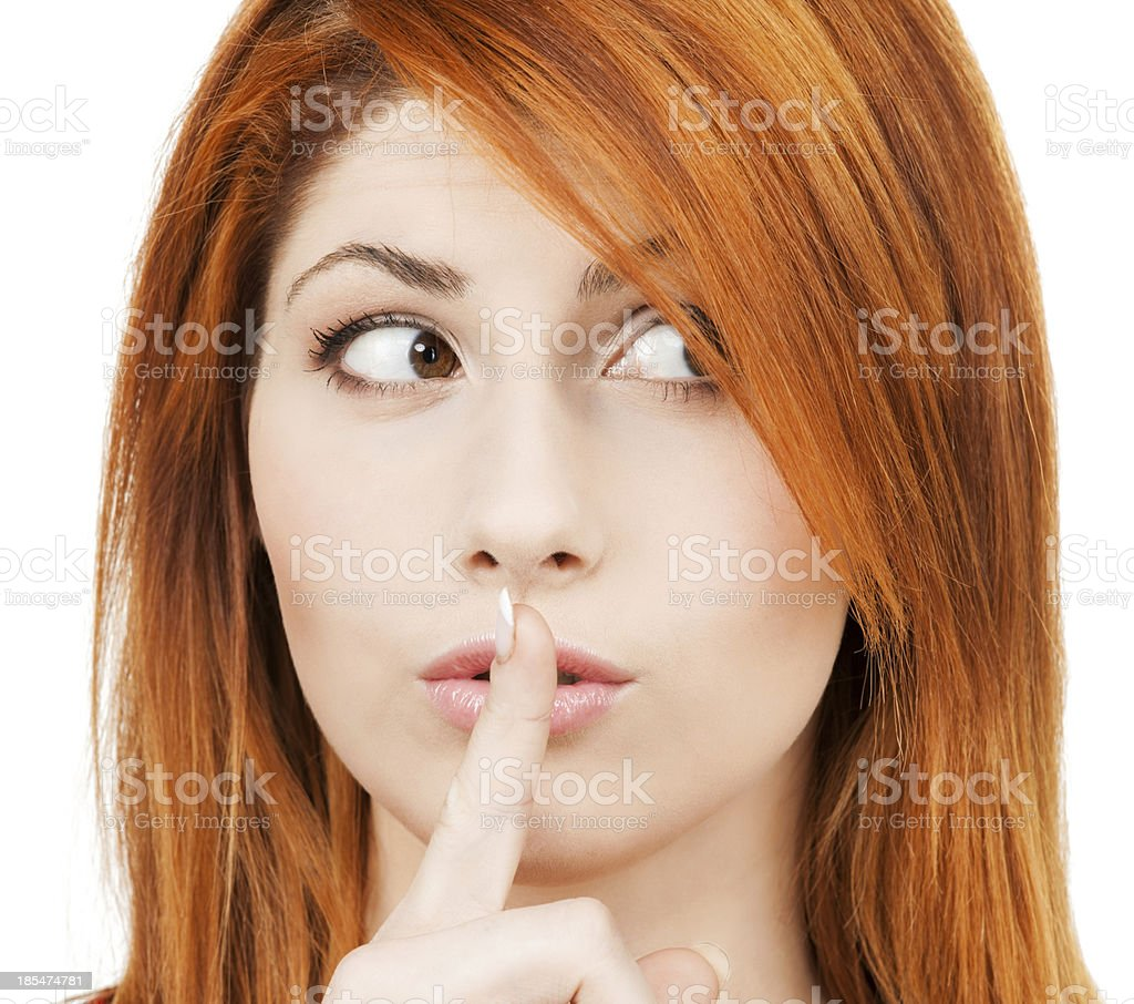 woman with finger on her lips royalty-free stock photo