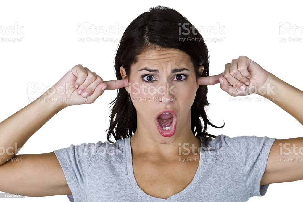 Woman with fingers in her ears stock photo