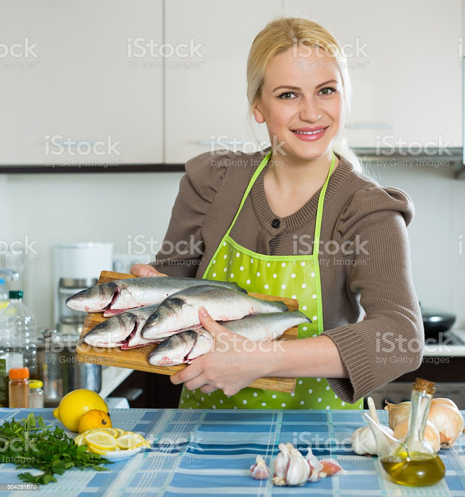 Woman with fish stock photo