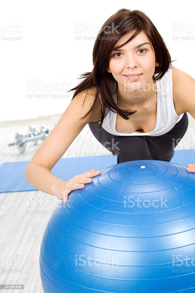Woman with fitness ball royalty-free stock photo