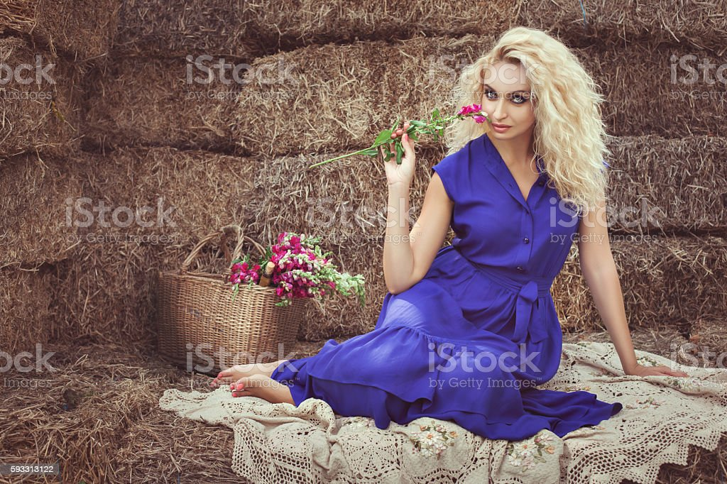 Woman with flower flirting. stock photo