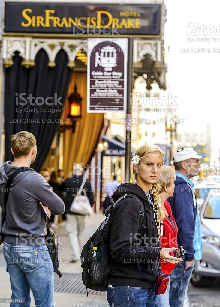 Woman with flower in head on San Francisco Street stock photo
