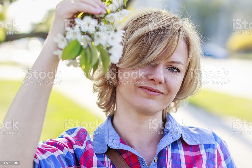 Woman with flower on tree royalty-free stock photo