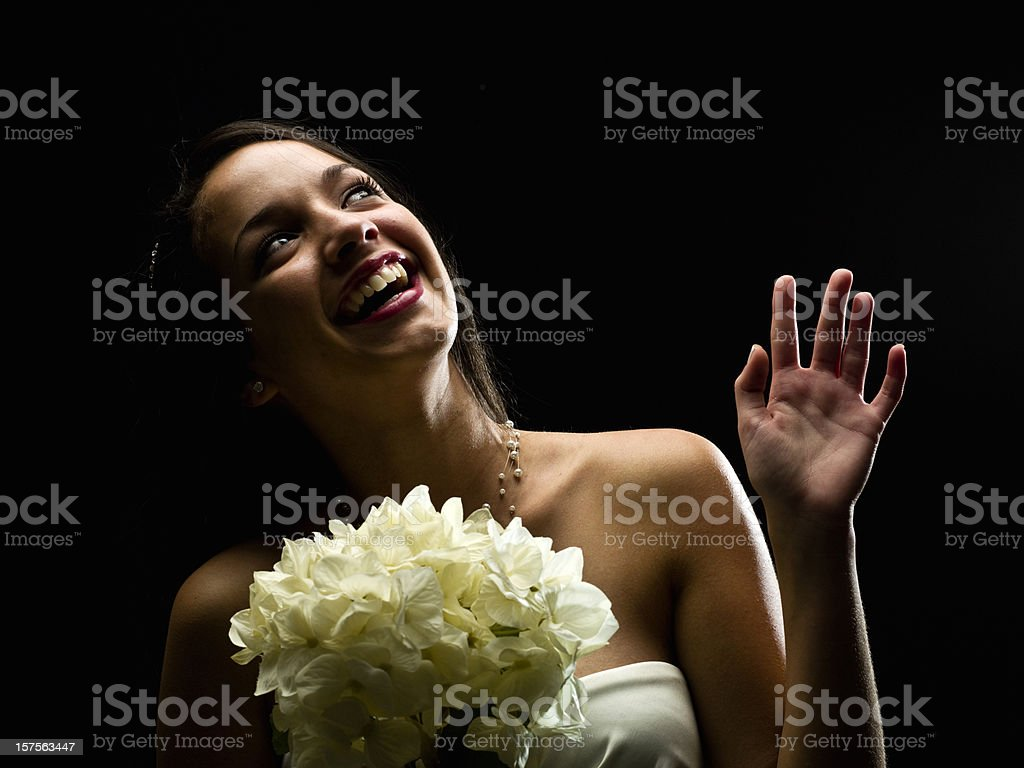 A woman with flowers dressed for a special night. royalty-free stock photo