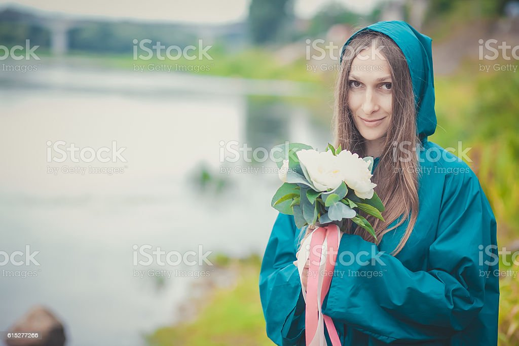 woman with flowers on the background of the river royalty-free stock photo