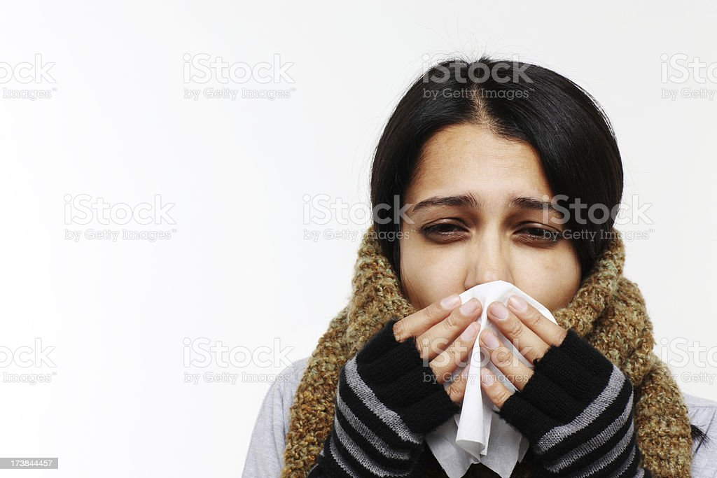 Woman with flu holding tissue stock photo