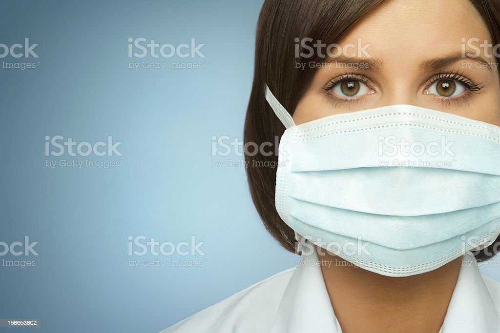 Woman With Flu Mask stock photo