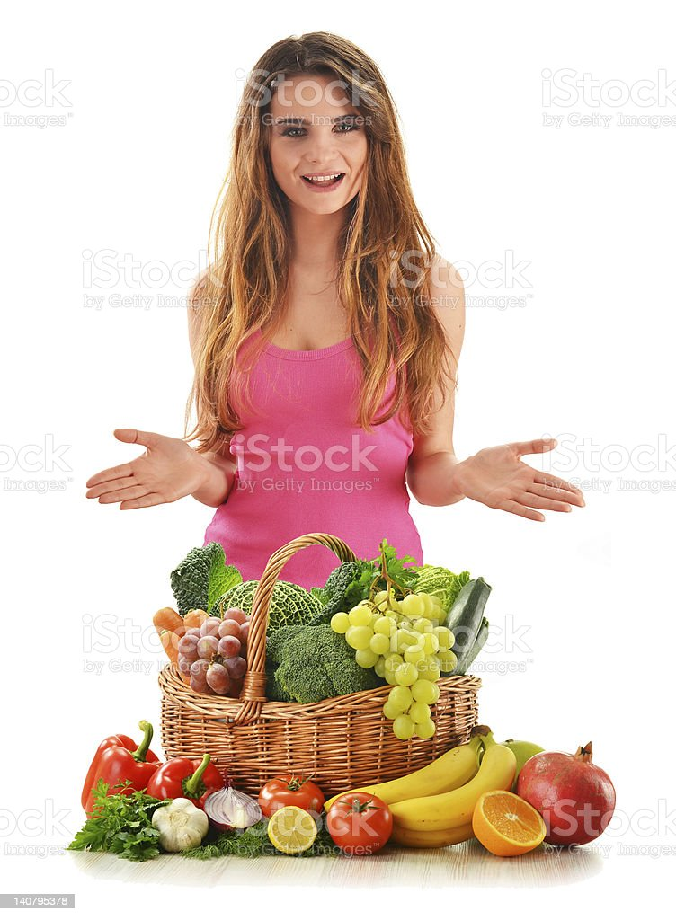 Woman with food products in wicker basket isolated on white royalty-free stock photo