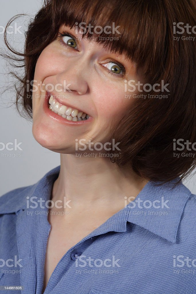 woman with forced smile stock photo