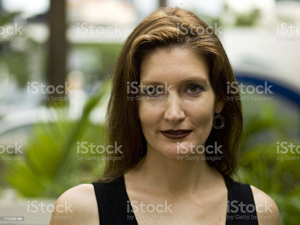 Woman with forty years old seeing the camera stock photo