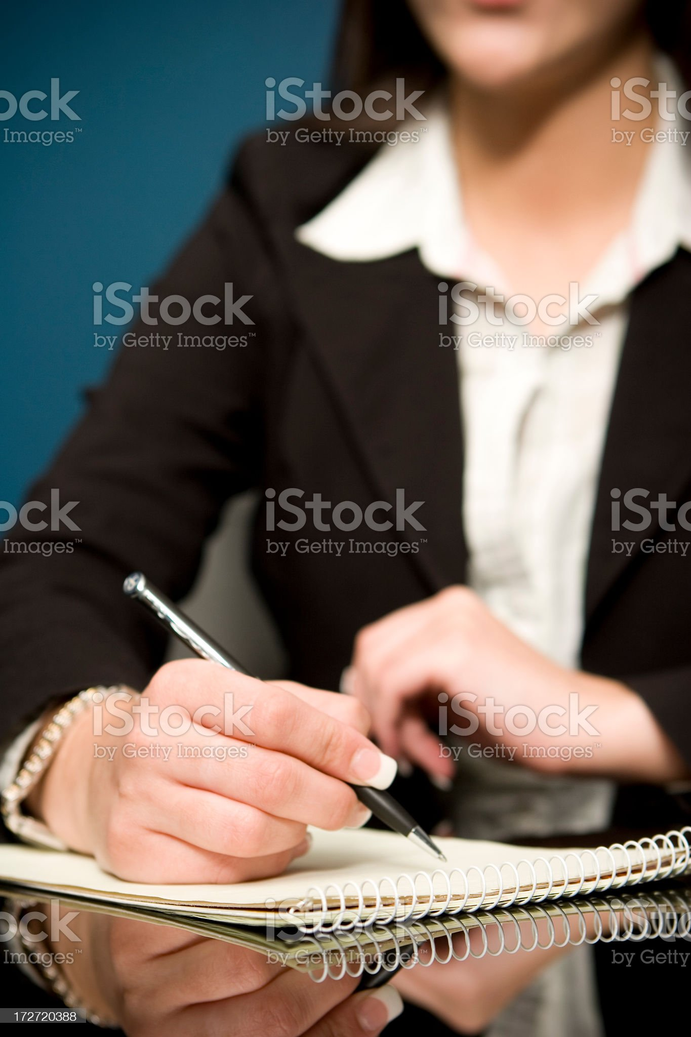 Woman with french manicure in a business suit taking notes royalty-free stock photo