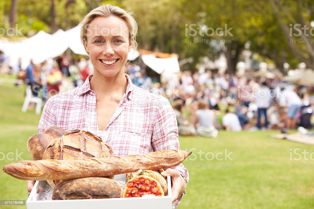 Woman With Fresh Bread Bought At Outdoor Farmers Market stock photo