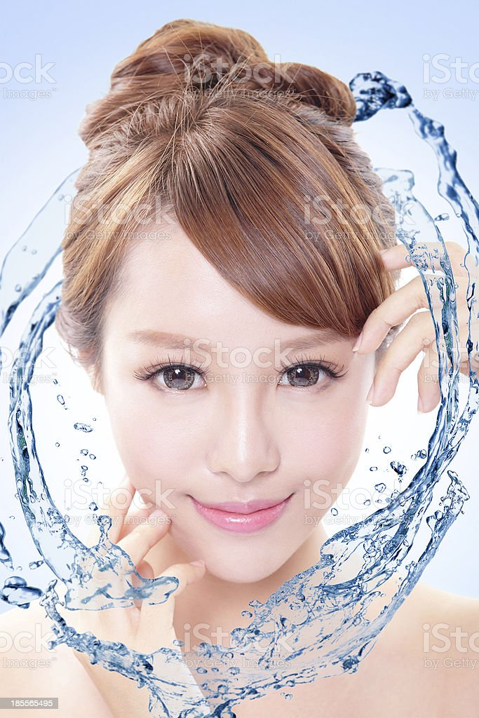 woman with fresh skin in splashes of water royalty-free stock photo