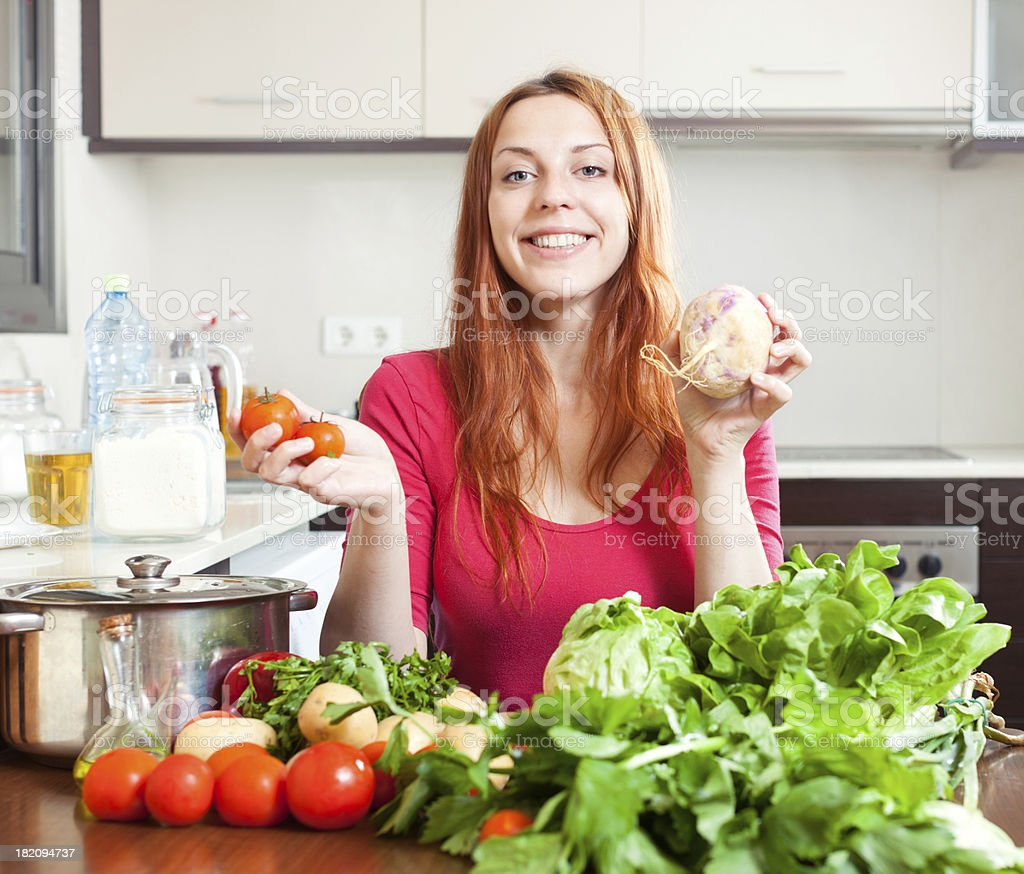 woman with fresh vegetables   in kitchen royalty-free stock photo