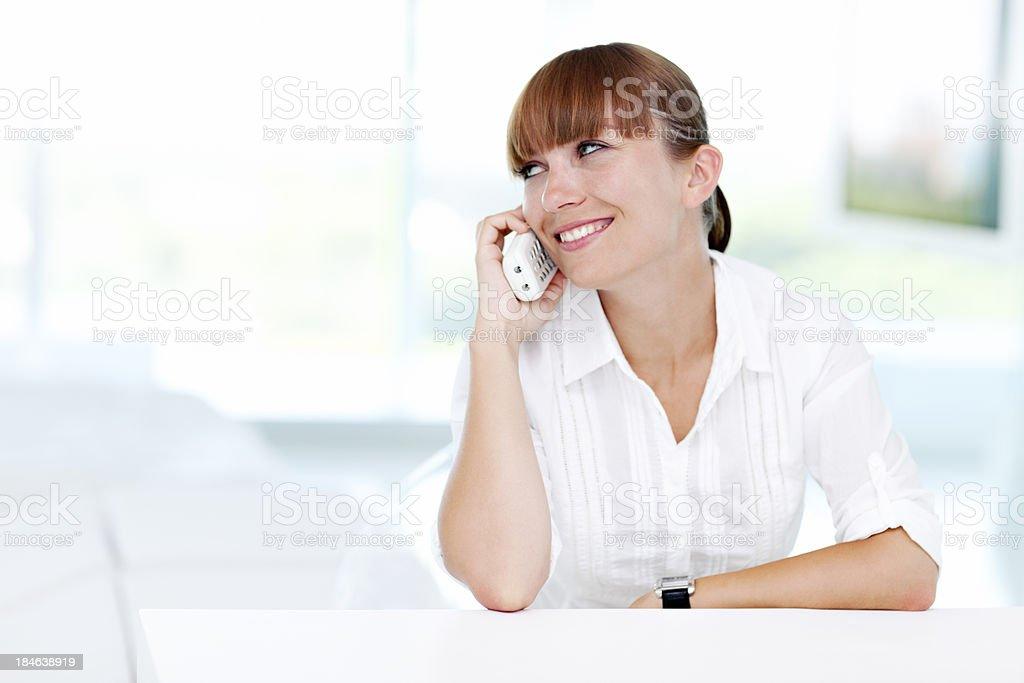 Woman With Fringe Talking On Phone stock photo