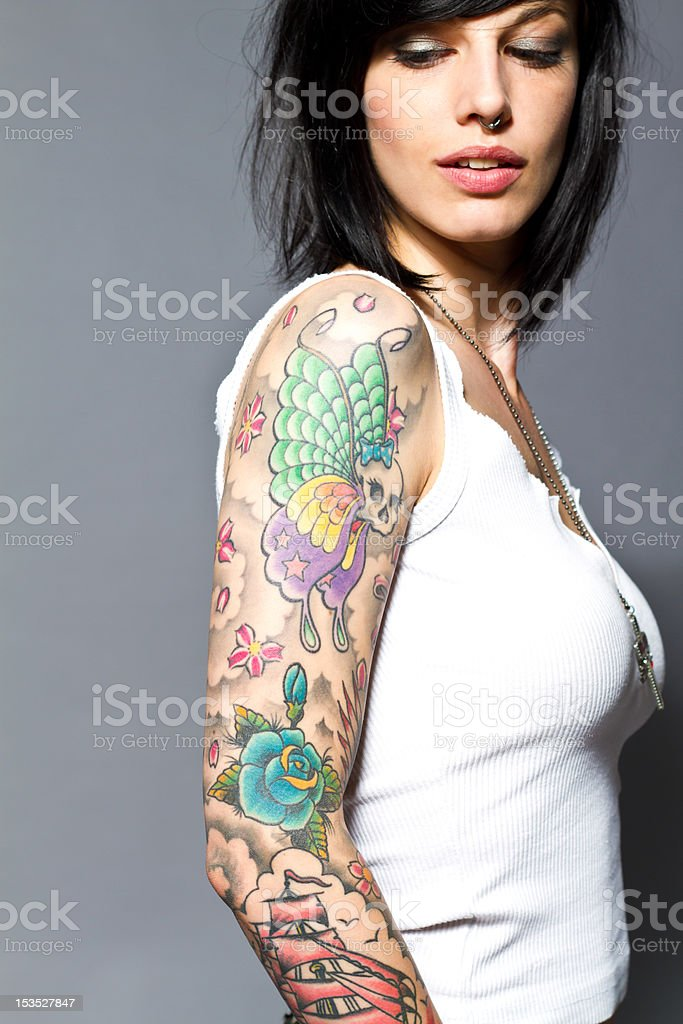 Woman with full-arm tattoos stock photo