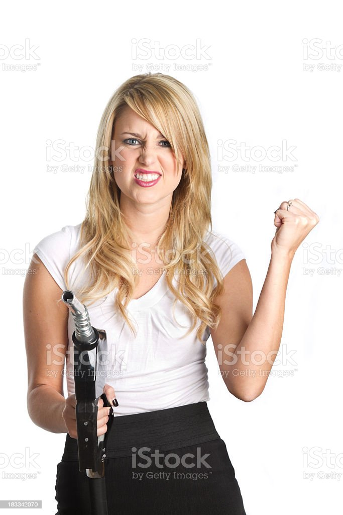 Woman with Gasoline Nozzle, Clenched Fist royalty-free stock photo