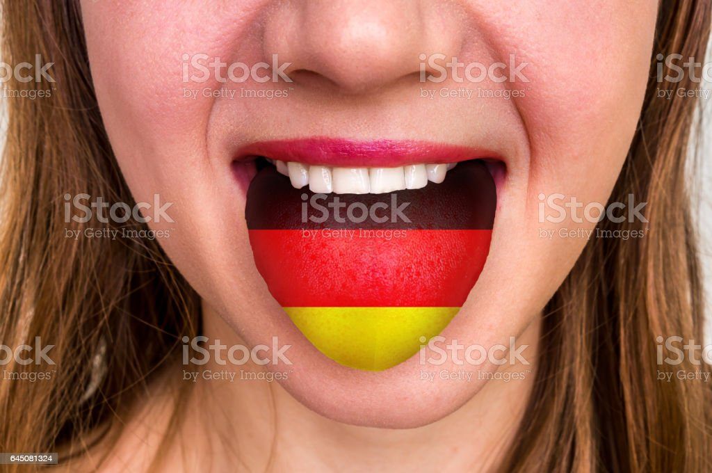 Woman with german flag on the tongue stock photo