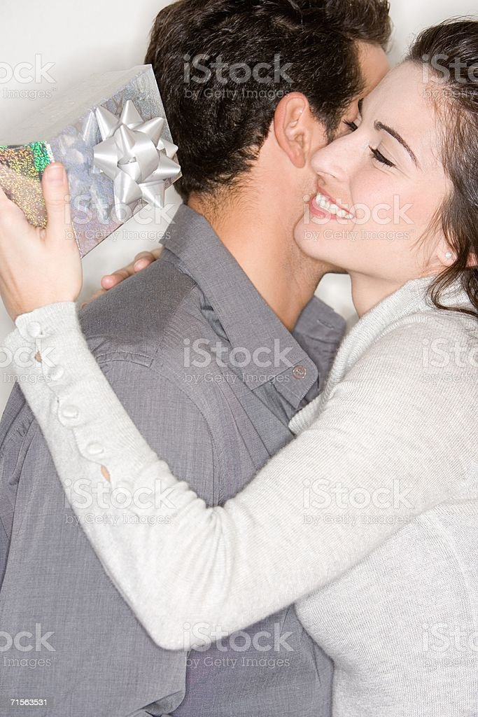 Woman with gift from husband stock photo