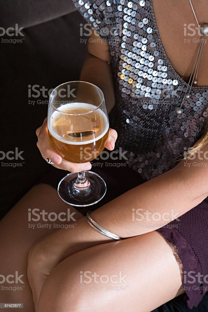 Woman with glass of lager stock photo