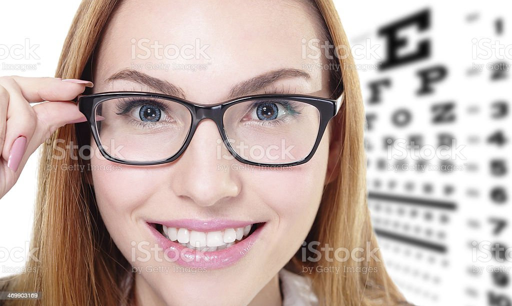 woman with glasses and eye test chart royalty-free stock photo