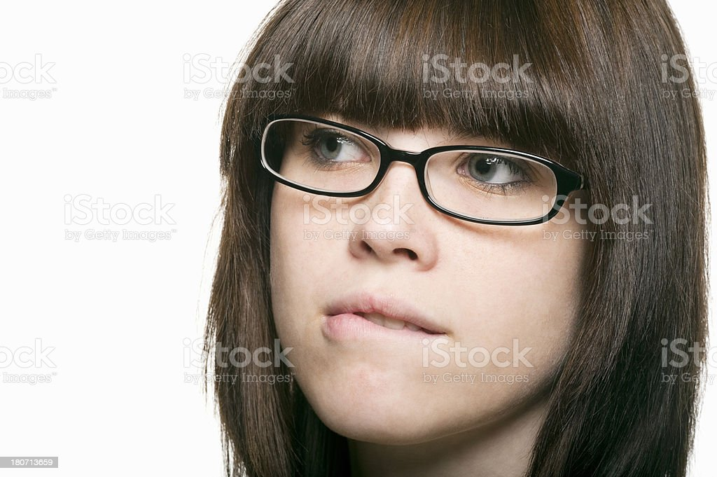 Woman with Glasses Biting Lip royalty-free stock photo