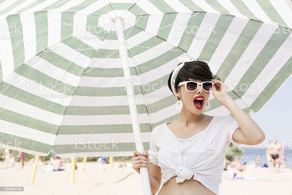 Woman with glasses on sunny beach stock photo