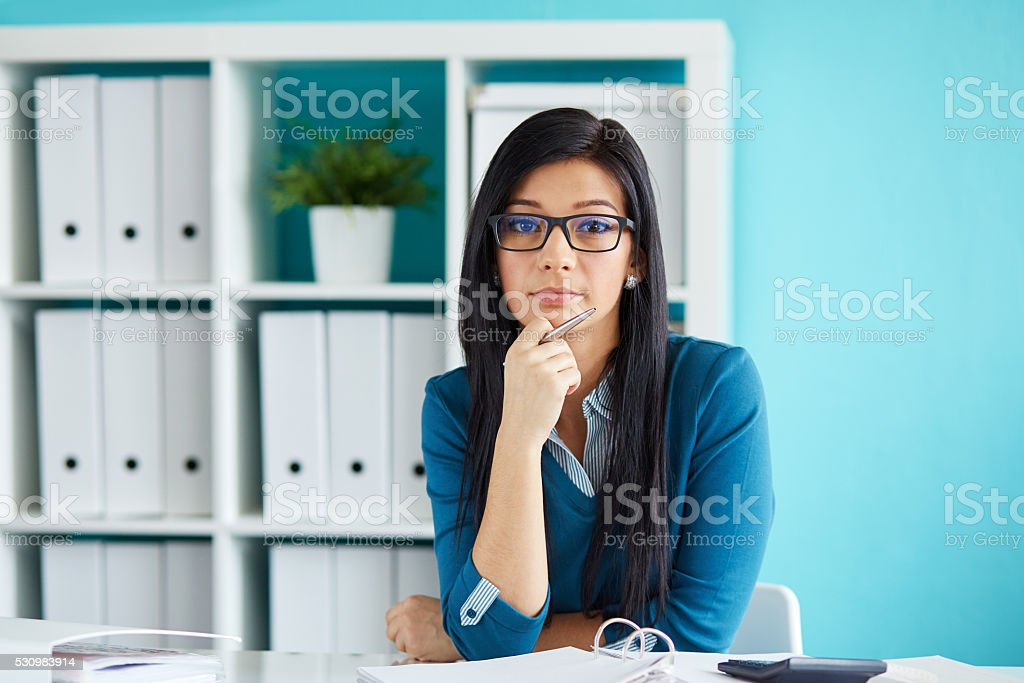 Woman with glasses working in office stock photo