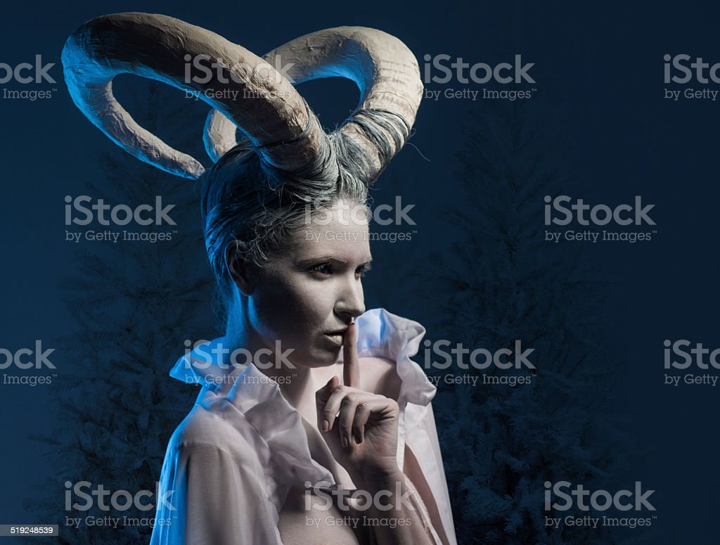 Woman with goat body-art stock photo