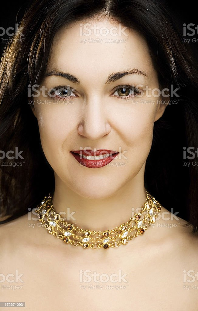 woman with gold necklace royalty-free stock photo