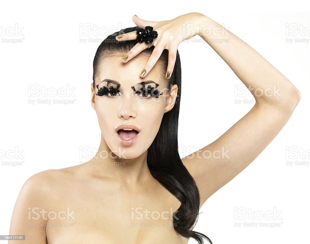 Woman with golden nails and style makeup royalty-free stock photo