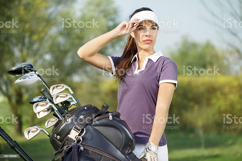 Woman with golf equipment royalty-free stock photo