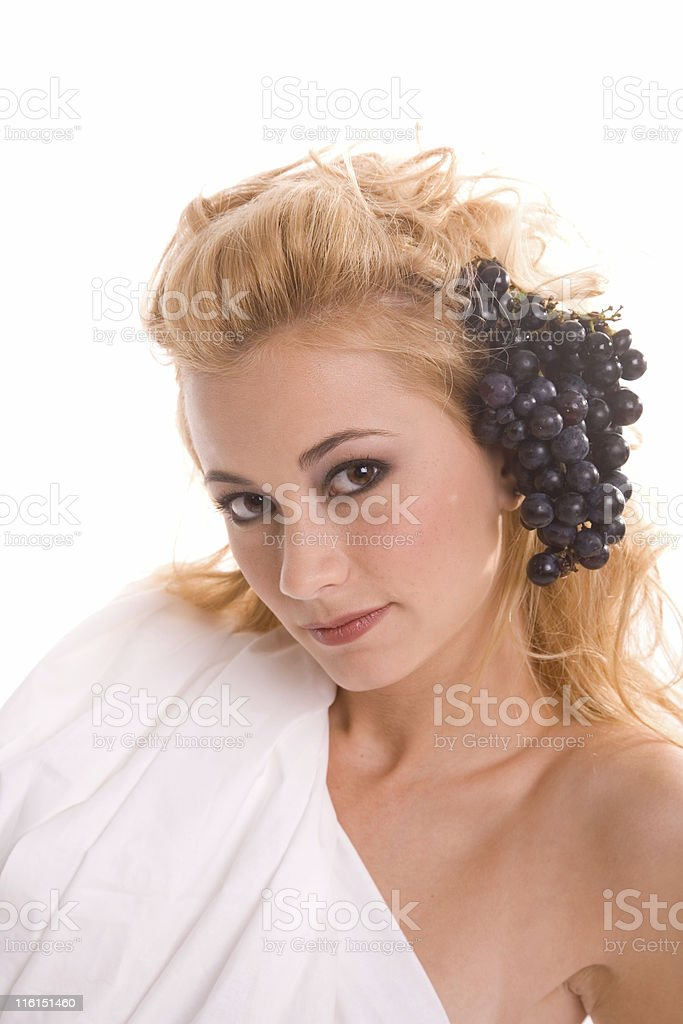 Woman with grapes in hair royalty-free stock photo
