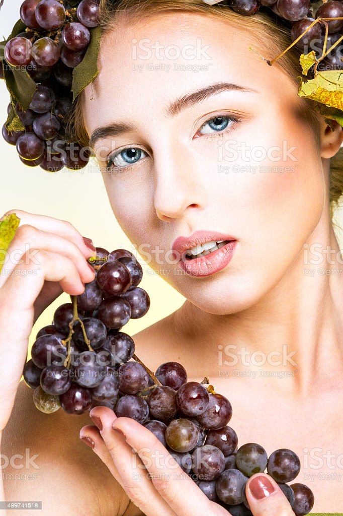 Woman with grapes royalty-free stock photo
